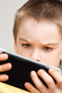 Boy-playing-with-electronic-device