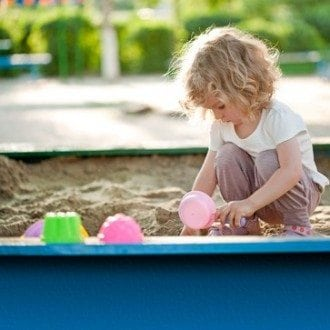 Girl Playing by Herself in playground