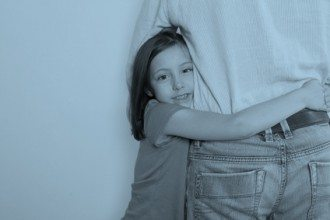 Little Girl Holding On to Father